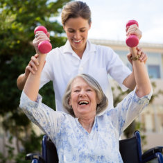 old woman having physical therapy with her health care assistant